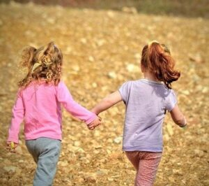 Two children walking together