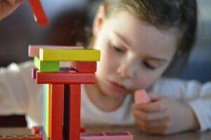 A child building with blocks