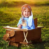 How to Pretend Play in 17 Fun Ways- child in mini airplane