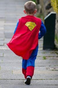 child dressed as superman