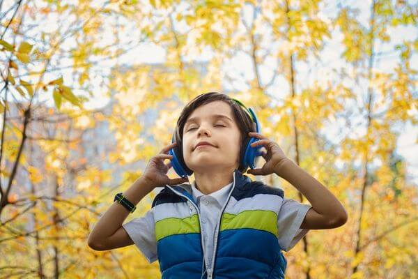 boy listening with headphones