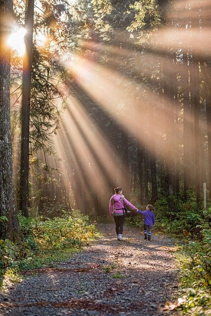 child and mother on a walk outside