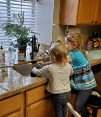 Social Distancing and Keeping Kids Connected- children washing dishes