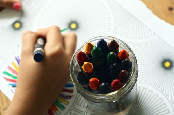 Home Activities for Kids-child coloring with crayons