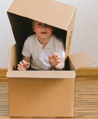 best monthly subscriptions for kids- child with box over head