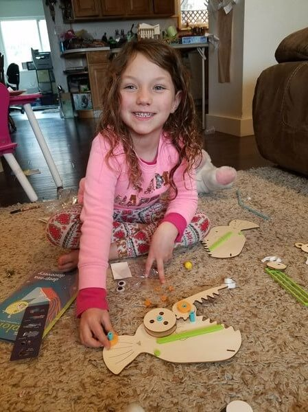 Kiwi Crate Review- young girl doing a project