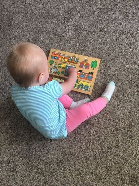 benefits of doing puzzles- toddler doing a puzzlea
