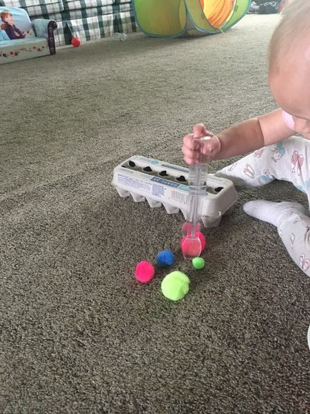 home activities for toddlers- tongs and pom poms