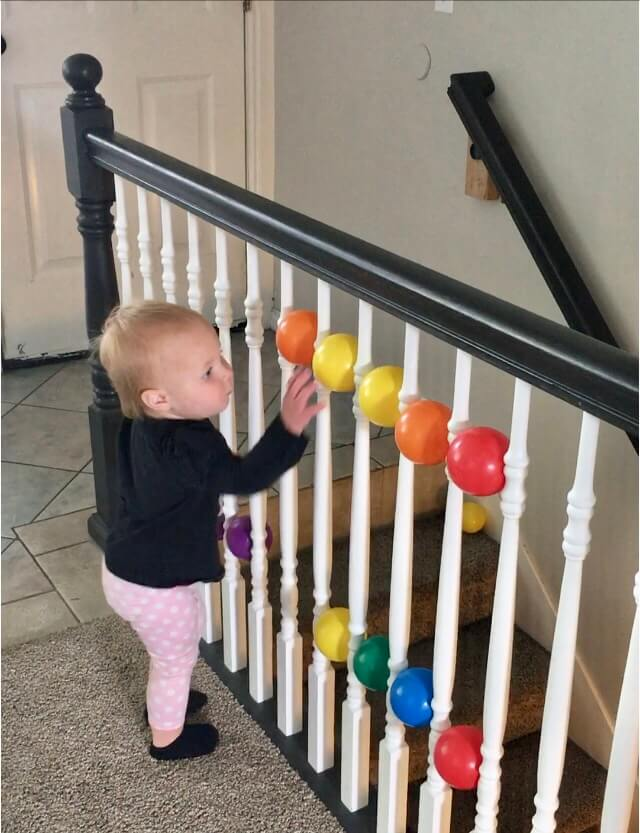 home activities for toddlers- banister and balls