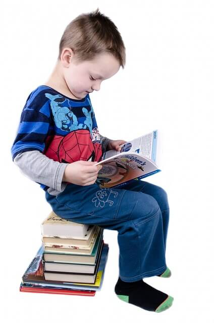 personalized books for children- boy with a stack of books