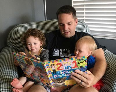 how to develop communication skills in toddlers- children reading with father