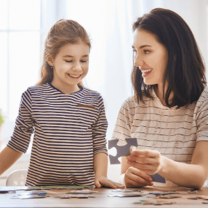 wooden puzzles for kids- child and mother doing a puzzle