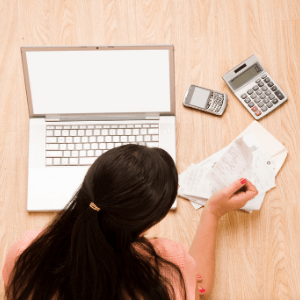 how to save money- tips to try today- lady calculating expenses