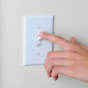 how to save money- tips to try today- switching a light off